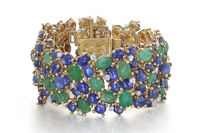 Andrew Grima S Gold Gem Set And Diamond Bracelet Features Carved Emeralds Cabochon Sapphires Of Various Sizes Mounted In 18 Karat